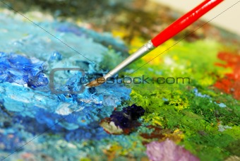 small painbrush is mixing colors