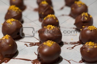 Close up of orange flavored chocolate truffles
