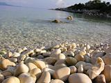 Close up of rock beach & sea