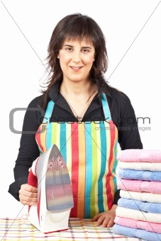 Housewife close to towels stacked