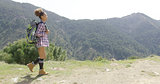 Sportive woman with backpack in mountains