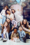 Lifestyle and people concept: young pretty diversity nations woman with different age children celebrating on birth day party together happy smiling, making selfie. African-american, asian and caucasian