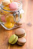 tasty colorful macarons in jar