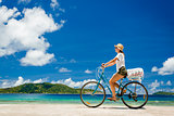 Woman ride along The Beach