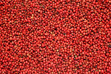 Pink peppercorns background
