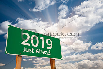 2019 Green Road Sign Over Clouds