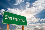 San Francisco Green Road Sign Over Clouds