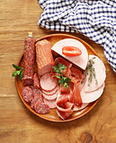 Assortment of meat delicacies (salami, parma, ham)