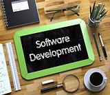 Software Development on Small Chalkboard. 3d.
