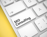 SEO Consulting - Text on White Keyboard Key. 3D.