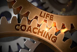 Life Coaching on Golden Metallic Cogwheels. 3D Illustration.