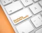 Developing Customer Loyalty - Inscription on White Keyboard Key.