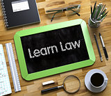 Learn Law Handwritten on Small Chalkboard. 3d.