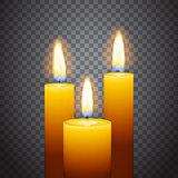 Set of three burning candles