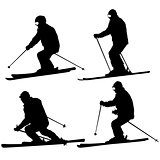 Set mountain skier speeding down slope. Vector sport silhouette