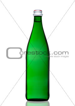 Green bottle of sparkling mineral water on white