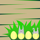 Cute Rabbits in Yellow Eggs on Grass
