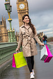 Woman Walking With Shopping Bags, Big Ben, London, England