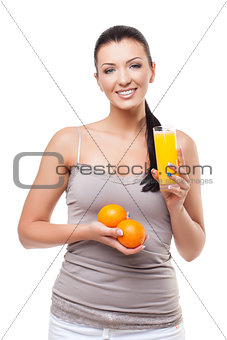Beautiful girl with oranges and orange juice