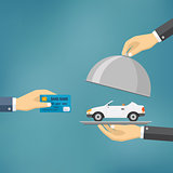Hands holding credit card and cloche with car.