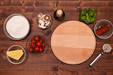 Ingredients to make a pizza at home - top view