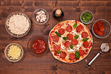 Phases of making a pizza - the ready to bake pizza, top view