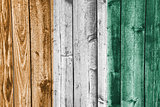 Flag of  Ivory Coast on weathered wood
