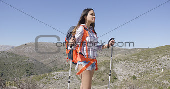 Attractive female traveller with backpack