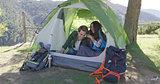 Smiling couple having fun in tent