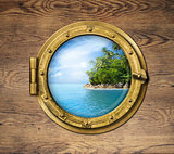 boat window or porthole with tropical island