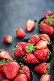 Fresh ripe strawberry on dark background