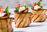 delicious Eggplant Rolls with feta cheese, tomato and basil leav