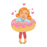 Little girl laughing and standing inside a big pink donut, a colorful character