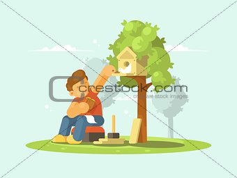 Boy feeding bird in birdhouse