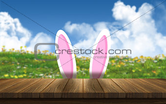 3D Easter bunny ears against a sunny landscape