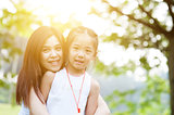 Asian mom and daughter portrait.