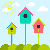 Nesting box cartoon set. Meadow with colorful bird houses.