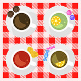 Set of coffee and tea cups top view on a checkered tablecloth surface.