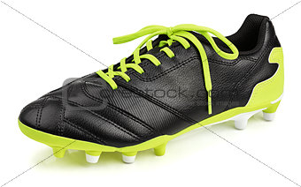 black leather football shoe or soccer boot isolated on white