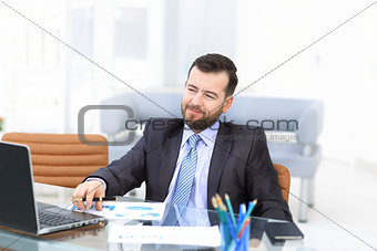 Business man using laptop and modern devices in office