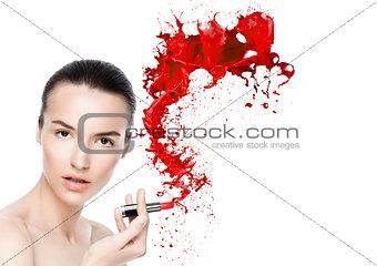 Beautiful model with lipstick tube paint splashes