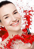 Beautiful model with lipstick tube paint splashes