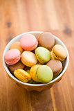 tasty colorful macarons in bowl
