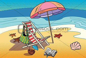 Beach lounger and sun umbrella