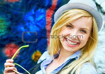Portrait of smiling hipster girl with sunglasses outdoors