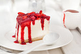 Delicious cheesecake decorated with berry sauce