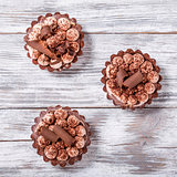 chocolate cupcakes on an old wood table, view from above, close-