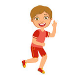 Little boy running in a red shirt and shorts and smiling, a colorful character