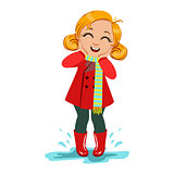Girl In Red Coat And Rubber Boots, Kid In Autumn Clothes In Fall Season Enjoyingn Rain And Rainy Weather, Splashes And Puddles