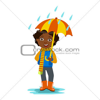 Boy With Open Umbrella Standing Under Raindrops, Kid In Autumn Clothes In Fall Season Enjoyingn Rain And Rainy Weather, Splashes And Puddles